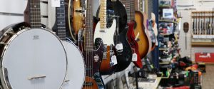 guitars hanging on the wall at Heath's Pawn Shop